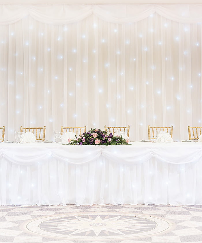 Starlight Backdrop and Starlight Top Table Skirt for hire