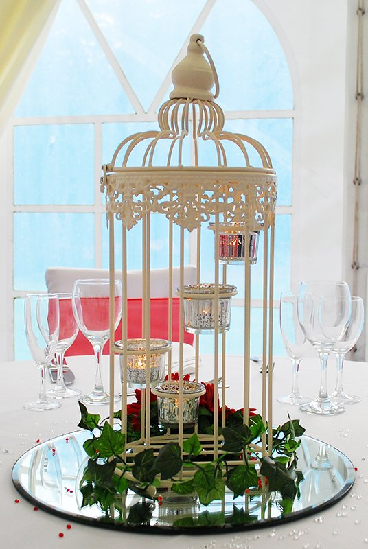 Tea lit bird cage flower